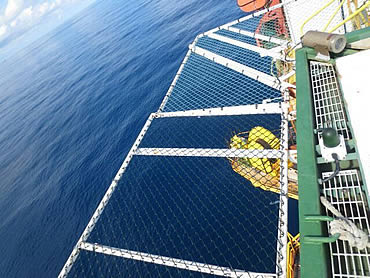 Chain link helideck meshes are installed on the offshore helideck lading deck