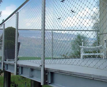 Stainless steel ferrule rope mesh is installed as balcony balustrade infill.
