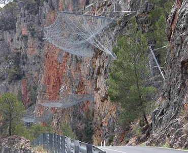 Slope protection rope mesh is installed vertically the slope instead of covering on the slope.
