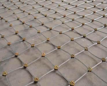 A large piece of slope protection rope mesh is on the floor.