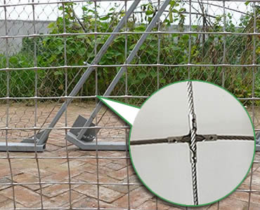 A piece of installed stainless steel square rope mesh with cross-shaped ferrules.