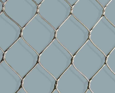 A piece of stainless steel knotted rope mesh.